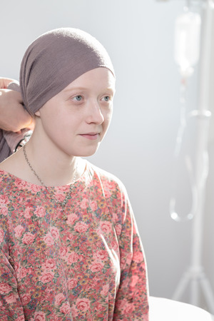 40088018 - portrait of cancer teenage girl wearing headscarf